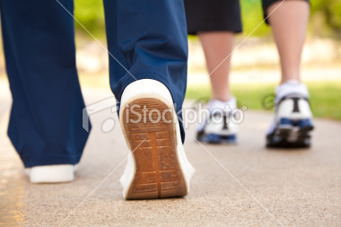 stock-photo-16288424-closeup-of-walker-s-shoes-on-a-pathway